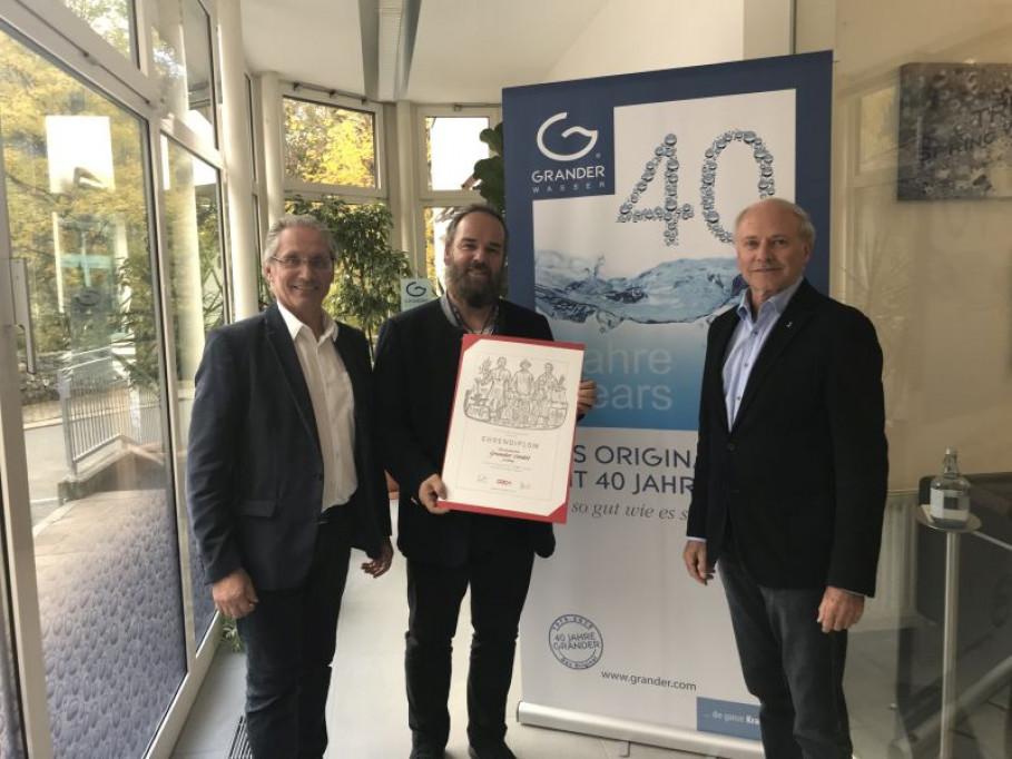 Diploma de honor de la Cámara de Comercio para Johann Grander